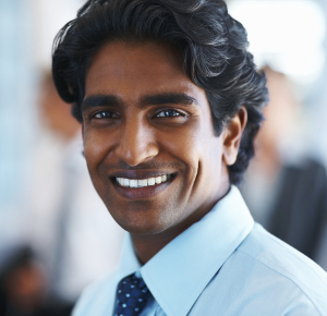 Portrait of a happy business man smiling confidently at work